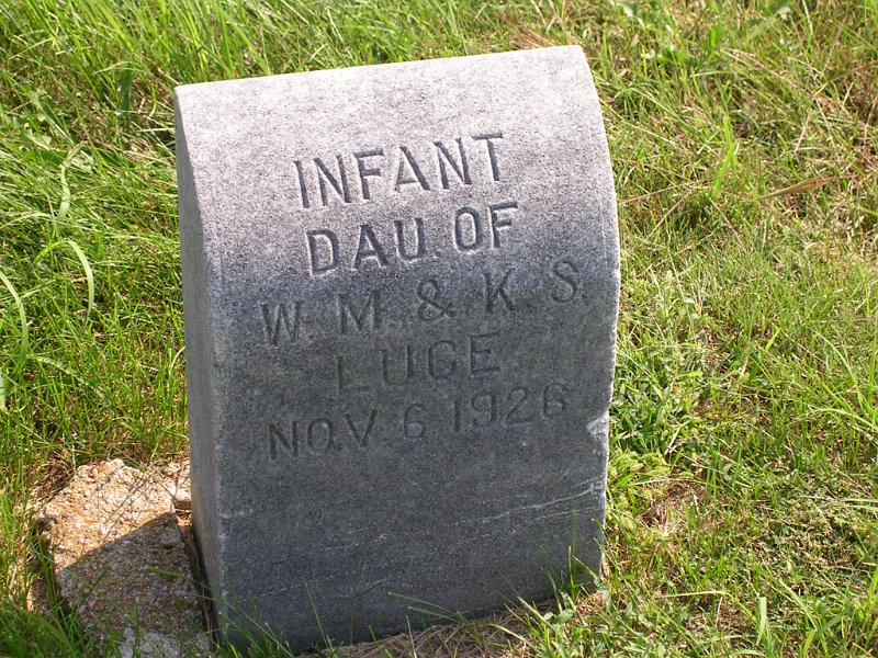 infant daughter Luce Grave Photo